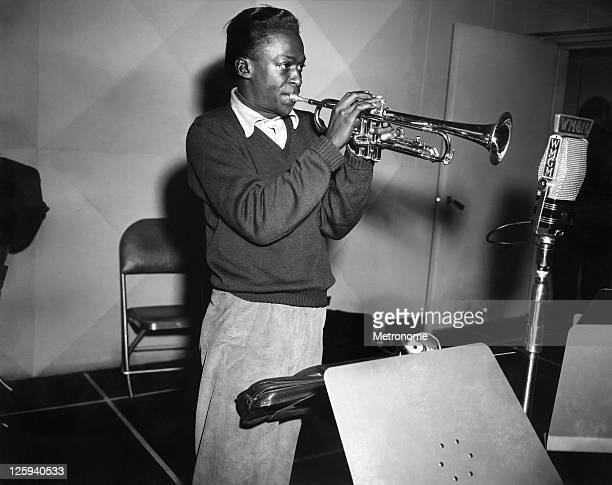 American jazz trumpeter Miles Davis rehearses in the studios of radio station WMGM for a session with the Metronome Jazz AllStars in 1951 in New york...