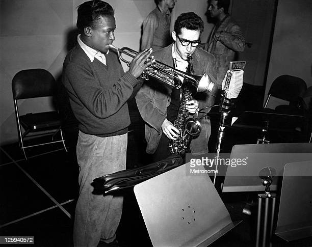 American jazz trumpeter Miles Davis rehearses in the studios of radio station WMGM with saxophonist Lee Koontz and the Metronome Jazz AllStars in...