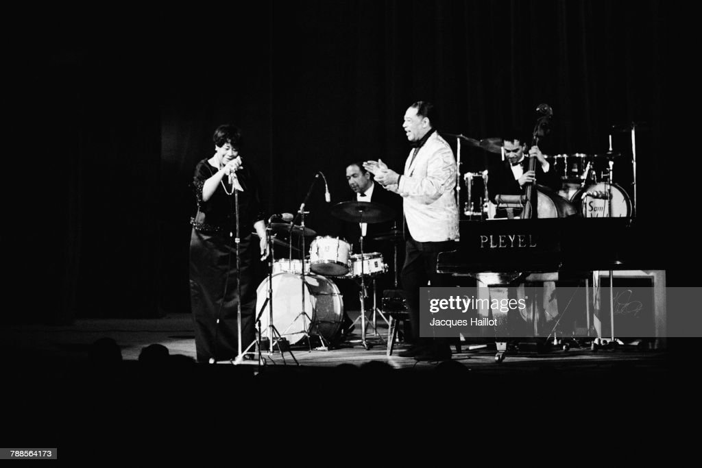 American jazz vocalist Ella Fitzgerald and composer, pianist, and jazz orchestra leader Duke Ellington on stage.