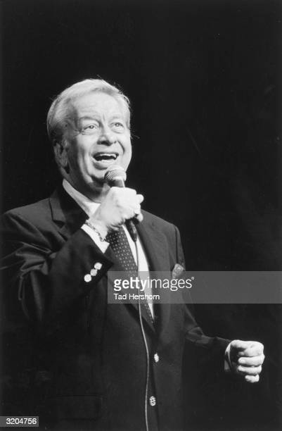 American jazz vocalist Mel Torme sings into a microphone at the Drum International Jazz Festival, Amsterdam, Netherlands.