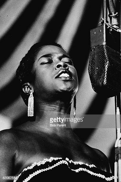 American jazz vocalist Sarah Vaughan closes her eyes as she sings during a performance at the Randall's Island Jazz Festival, New York, New York,...