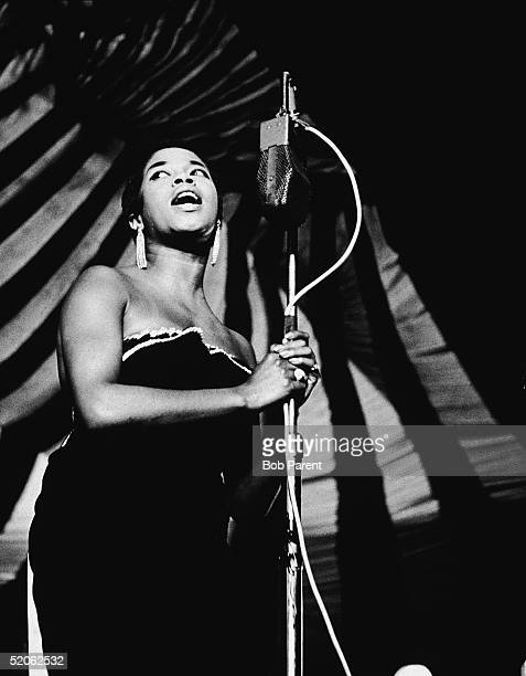 American jazz vocalist Sarah Vaughan grips the microphone as she sings on stage at the Randall's Island Jazz Festival, New York, New York, August 23,...