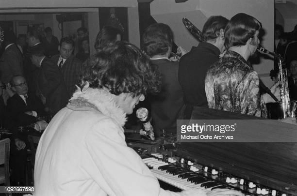 American jazzrock band Blood Sweat Tears performing at Steve Paul's nightclub The Scene in New York City 25th November 1967 Musician Al Kooper is at...