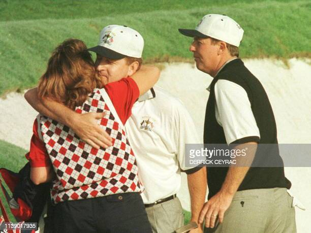 American Jeff Maggert kissing his wife Kelli after winning with Scott Hoch the foursome match against Nick Faldo and Lee Westwood during the last day...
