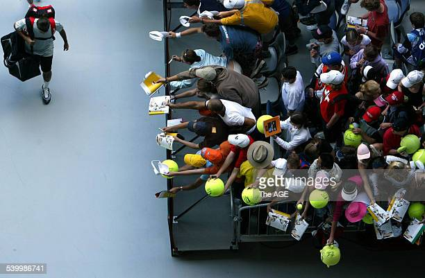 American Jeff Morrison leaves the court after losing to Roger Federer of Switzerland as fans wait for autographs at the Australian Open at Melbourne...