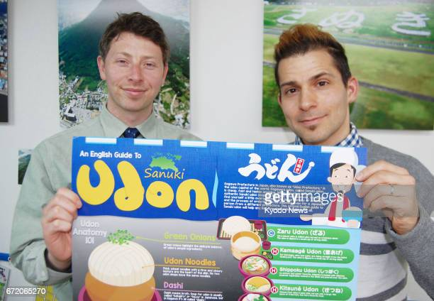 American Jeremy Lanig and his British coworker Gary Wilkinson English teachers from a Kagawa Prefecture language school hold a poster in the western...
