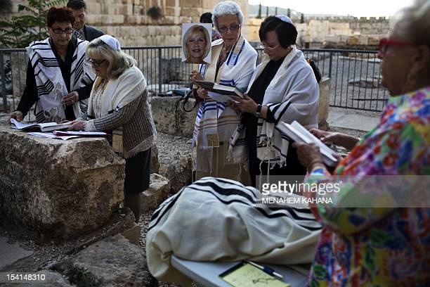 American Jewish women from Florida wearing the Talit read the Torah during their late Bat Mitzvah which is the Jewish tradition maturity ceremony...