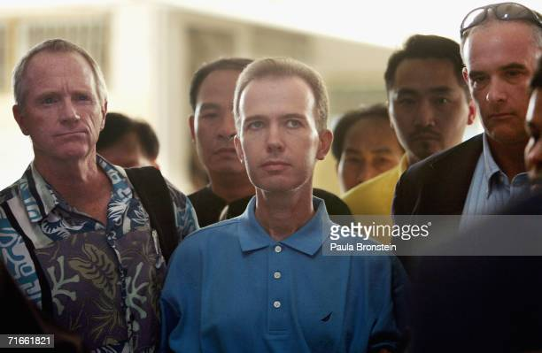 American John Mark Karr is held by US and Thai authorities at an immigration office on August 17 2006 in Bangkok Thailand Karr has confessed to being...