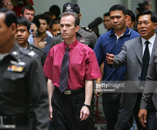 American John Mark Karr is led by Thai police from the immigration detention facility to the airport to depart for the US August 20 2006 in Bangkok...