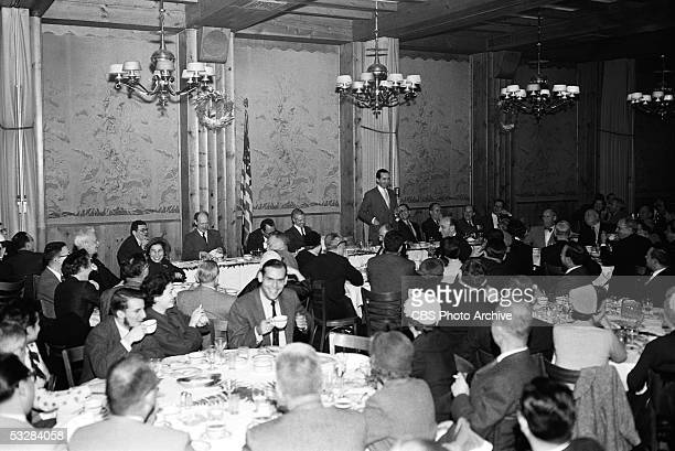 American jounalist Edward R Murrow stands at a microphone and addresses the Overseas Press Club at a ccrowded luncheon held in Toots Shor's...