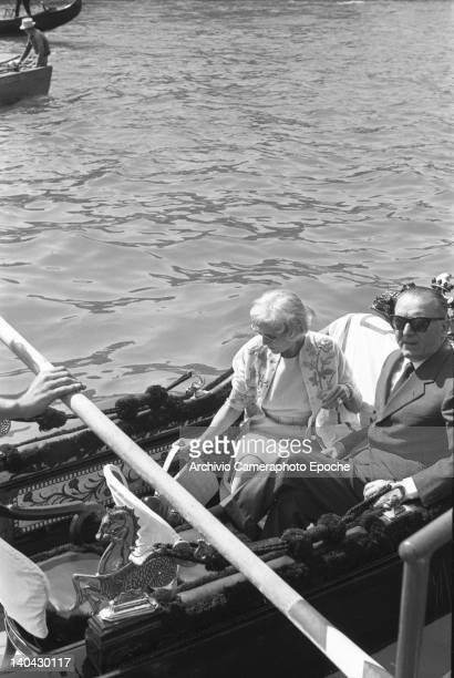 American journalist and ambassador Clara Booth Luce with ambassador Grandi sitting on a gondola Venice 1960s