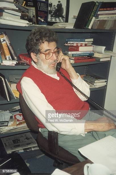 American journalist and music critic Nat Hentoff makes a telephone call at his desk in the office of the Village Voice newspaper New York New York...