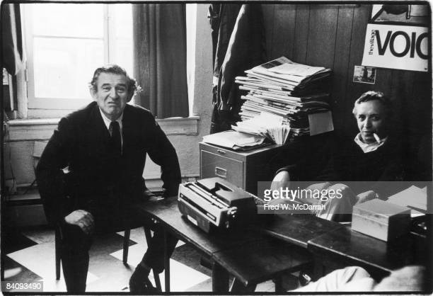 American journalist and Village Voice cofounder and editor Daniel Wolf sits with author Norman Mailer in the Voice's offices in Sheridan Square New...
