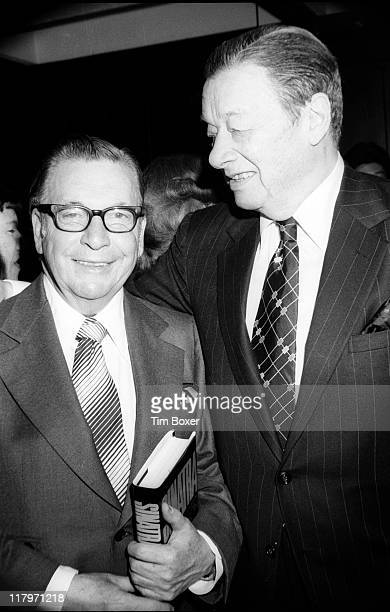 American journalist Earl Wilson a copy of his book 'Sinatra An Unauthorized Biography' under his arm poses with restaurateur Toots Shor during the...