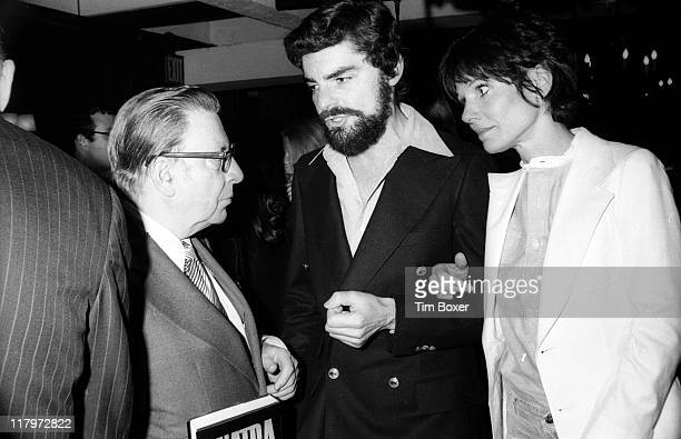 American journalist Earl Wilson speaks with married American actors Richard Benjamin and Paula Prentiss during the publication party for Wilson's...