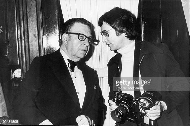 American journalist Earl Wilson speaks with photographer Tim Boxer at the New York Film Critics Awards New York New York January 20 1974