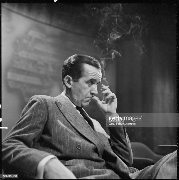 American journalist Edward R Murrow smokes a cigarette on the set of the annual news roundup dubbed 'Years of Crisis' January 2 1955