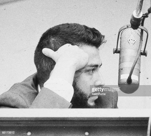 American journalist novelist and critic Nat Hentoff seated behind a microphone circa 1960