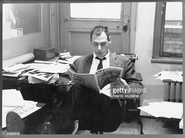 American journalist Thomas Hess managing editor of Art News reads at his desk New York New York February 15 1961
