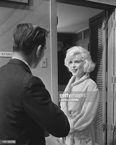 APPLY American journalist Tommy Thompson interviews American actress Marilyn Monroe for Life magazine outside her dressing room on the set of...