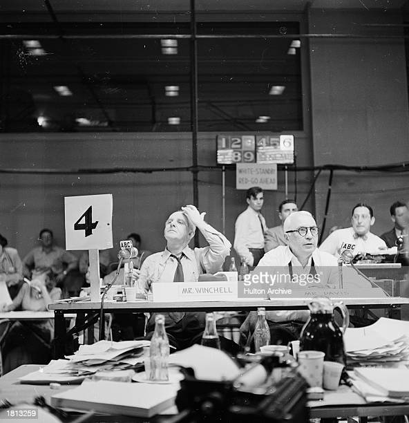 American journalist Walter Winchell sits at a press table covering the presidential election for an ABC news radio broadcast November 1948 An...