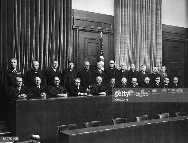 American judges of the OMGUS war crimes tribunals at the bench of the main courtroom in the in Nuremberg Palace of Justice Germany circa 1945 Front...