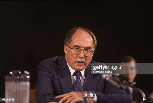 American jurist William Rehnquist sits behind a microphone as he answers questions during the hearings regarding his nomination as Chief Justice of...