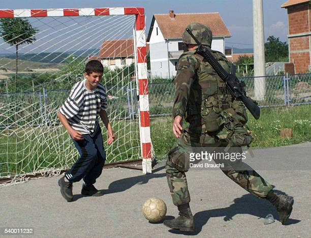 American KFOR soldier Zack Wojenski playing with a young Serb