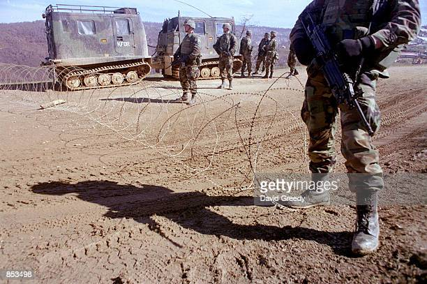 American KFOR soldiers block the road to the small village of Debelde Kosovo March 8 2001 The village was reportedly being used by armed Albanian...