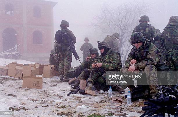 American KFOR soldiers have their lunch in the small southern village of Debelde Kosovo March 6 2001 The village near the Macedonian border was...