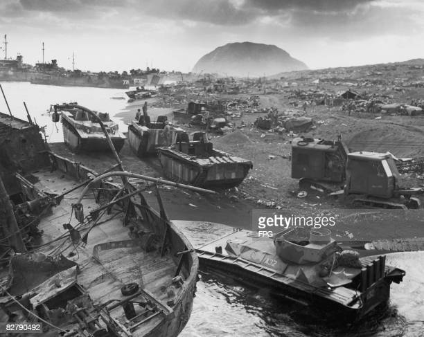 American landing craft and armoured vehicles on a beach during the Battle of Iwo Jima February 1945