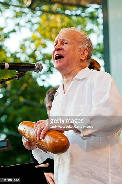 American Latin and soul musician Johnny Colon plays guiro leads his orchestra during an evening of Boogaloo music at Central Park SummerStage New...