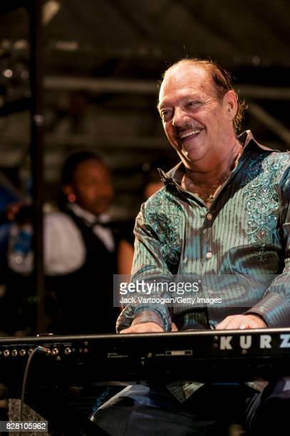 American Latin Jazz musician Larry Harlow plays keyboards onstage at Damrosch Park Bandshell at Lincoln Center Out of Doors New York New York August...