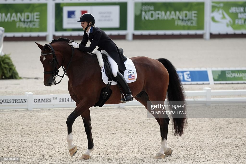 American Laura Graves rides Verdades on August 26, 2014 during the second session of the Dressage Grand Prix of the 2014 FEI World Equestrian Games at D'Ornano Stadium in the northwestern French city of Caen.