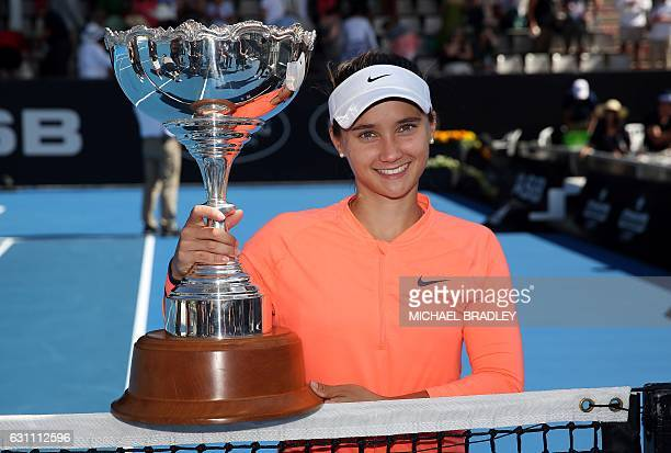 American Lauren Davis celebrates winning against Croatia's Ana Konjuh after their women's singles final match at the WTA Auckland Classic tennis...
