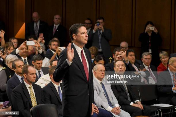American lawyer and former FBI Director James Comey is sworn in before his testimony before the Senate Intelligence Committee Washington DC June 8...