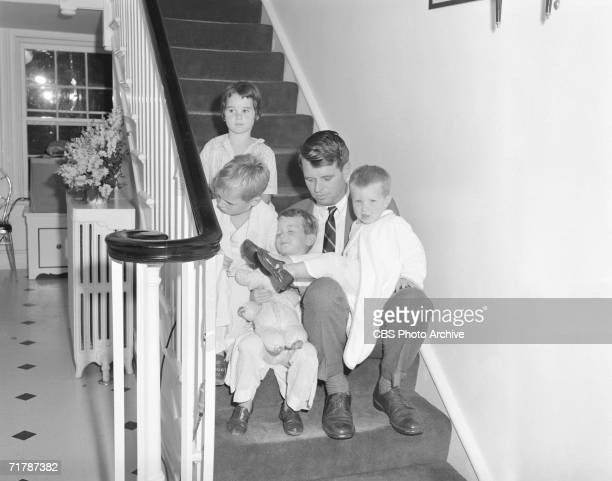 American lawyer and later politician Robert Kennedy sits with four of his eventually eleven children Kathleen Joseph Robert Jr and David on the steps...