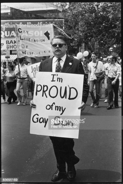 American lawyer Dick Ashworth marches with a sign that reads 'I'm Proud of My Gay Son' in the Fifth Annual Gay Pride Day march New York New York June...