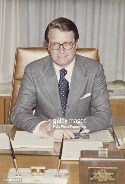 American lawyer diplomat and politician Elliot Richardson United States Ambassador to the United Kingdom pictured seated at his desk at the United...