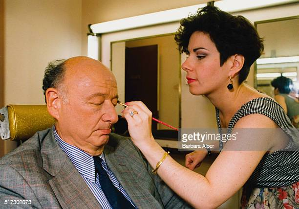 American lawyer politician political commentator and past mayor of New York City Ed Koch has makeup applied before appearing on telelvision USA June...