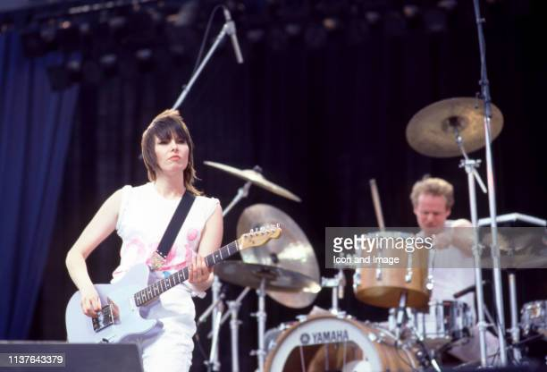 American lead singer Chrissie Hynde and English drummer Martin Chambers of the rock group The Pretenders play on stage during the 1983 United States...