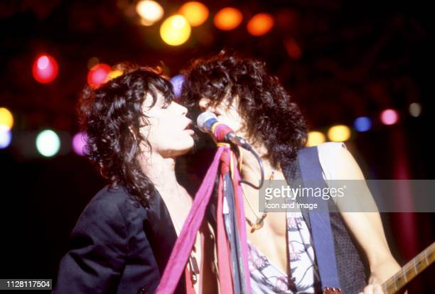 American lead singer Steven Tyler and lead guitarist Joe Perry of the group Aerosmith sing and play on stage during the 1984 Back in the Saddle Tour...