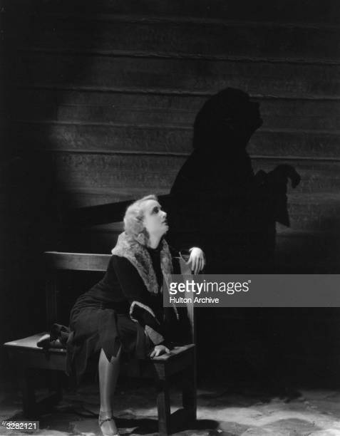 American leading lady and comedienne Carole Lombard formerly Jane Peters casts a winsome shadow on the wall in a scene from the early talkie 'High...