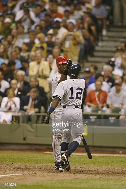 American League All Star left fielder Garret Anderson of the Anaheim Angels greets second baseman Alfonso Soriano of the New York Yankees at home...