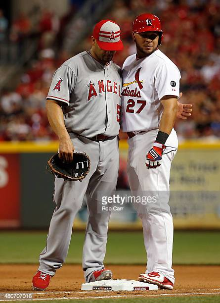 American League AllStar Albert Pujols of the Los Angeles Angels of Anaheim speaks with National League AllStar Jhonny Peralta of the St Louis...