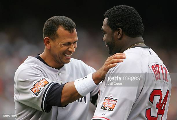 American League AllStar Alex Rodriguez of the New York Yankees laughs with David Ortiz of the Boston Red Sox prior to the 78th Major League Baseball...