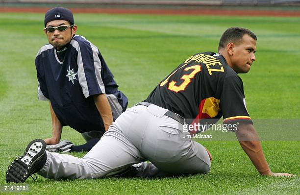 American League AllStar Alex Rodriguez of the New York Yankees warms up with Ichiro Suzuki of the Seattle Mariners on the field before the 77th MLB...