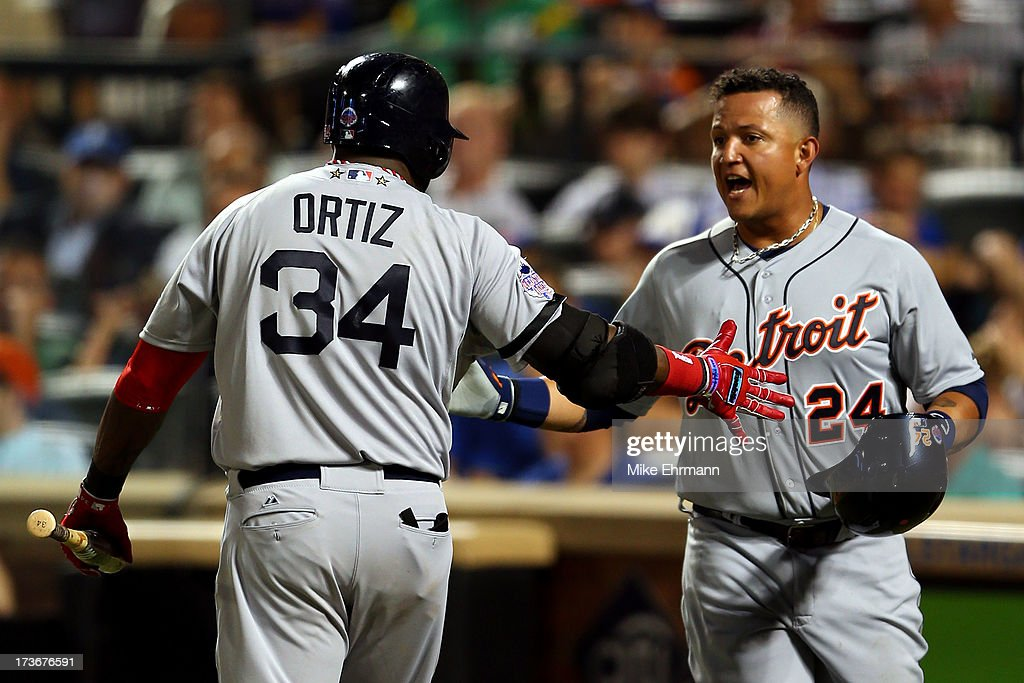 American League All-Star David Ortiz #34 of the Boston Red Sox greets American League All-Star Miguel Cabrera #24 of the Detroit Tigers after Cabrera scored in the fourth inning during the 84th MLB All-Star Game on July 16, 2013 at Citi Field in the Flushing neighborhood of the Queens borough of New York City.