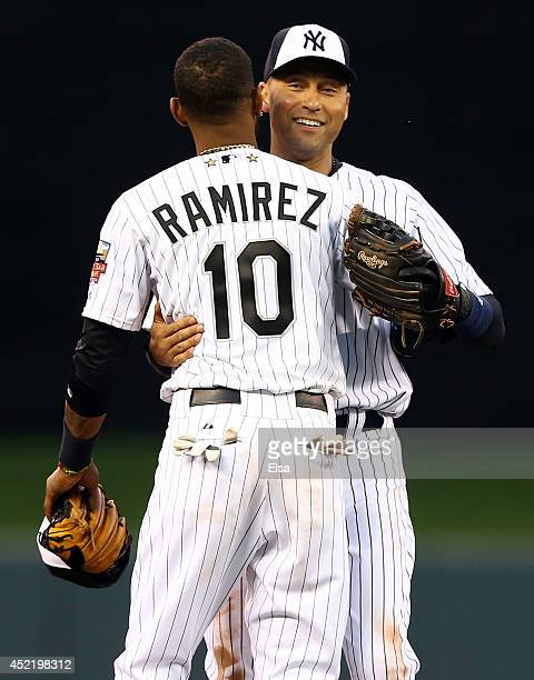 American League AllStar Derek Jeter of the New York Yankees hugs replacement Alexei Ramirez of the Chicago White Sox after being pulled in the fourth...