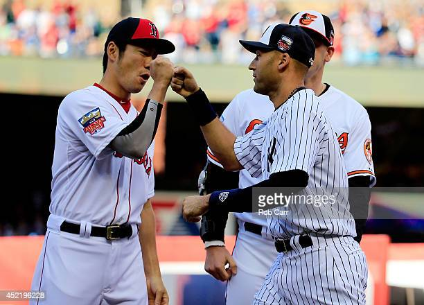 American League AllStar Derek Jeter of the New York Yankees is greets Koji Uehara of the Boston Red Sox prior to the 85th MLB AllStar Game at Target...